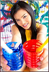 Thai Girls Holding Paint Pots Smiling Broadly