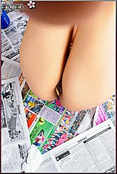 Laid On Newspapers Legs Raised Bare Ass