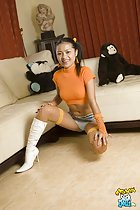 Jantra squatting on floor skirt rising up exposing her panties wearing white high heeled boots