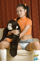 Holding stuffed toy seated with legs spread panties exposed