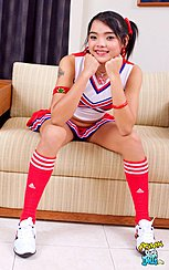 Sitting On Edge Of Sofa Wearing Cheerleader Outfit