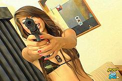 Holding Pistol Wearing Camouflage Bikini