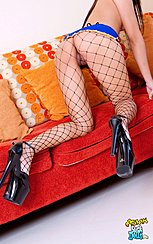 On All Fours On Sofa In Fishnet Stockings Pussy Exposed High Heels
