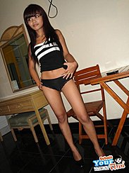 Standing In Black Top Wearing Panties Hand On Hip Wearing High Heels Long Hair