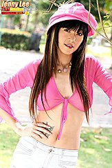 Standing With Hand On Hip Wearing Pink Knotted Top And Hat In White Shorts Long Hair