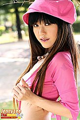 Jenny Lee Looking Over Her Shoulder In Pink Cap And Top Long Hair