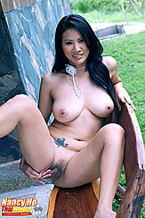 Sitting Naked On Bench Baring Big Breasts Legs Parted Spreading Her Pussy Lips