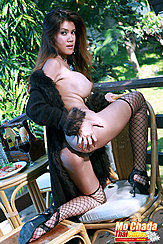 Kneeling On Chair Looking Over Her Shoulder Clutching Her Ass Big Breast In Profile In Black Fishnet Stockings