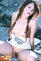 Seated With Legs Open Exposing Her Pussy Pigtails Framing Her Small Breasts