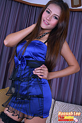 Hannah Lee With Hand On Hip Long Hair Falling Over Her Shoulder In Dress