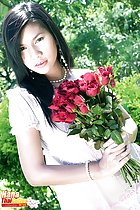 Hana holding roses long hair pearl necklace