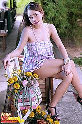 Seated In Summer Dress Legs Crossed Wearing High Heels