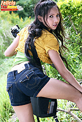 Felicia Setting Up A Shot Looking Back In Denim Shorts