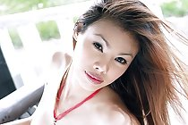 Beauty May Supha strips red top on lounger baring big breasts
