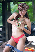 Angy Lung cupping her small breasts in red panties