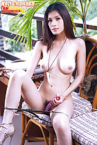Natt Chanapa seated nude necklace between her breasts legs open wearing high heels using vibrator on her pussy