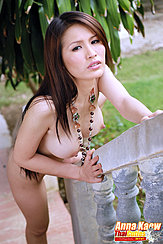 Anna Kaew Standing At Foot Of Balustrade Nude Playing With Necklace Long Hair Big Pert Breasts
