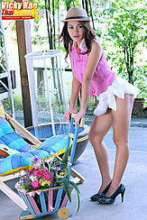 Pushing Wheel Barrow In High Heels Wearing Short Skirt