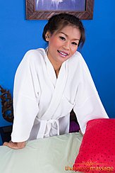 Leaning On Massage Table Wearing Robe