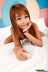 Brownie Leaning Forward On Bed Displaying Cleavage