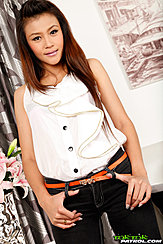 Long Hair Over Her White Top Thumbs In Belt Loops Of Her Jeans
