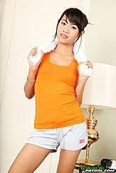 Towel Around Her Shoulders Wearing Orange Top In Shorts