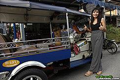 Standing Beside Tuktuk Giving Thumbs Up