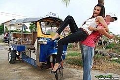 Raised Up Beside Tuktuk Wearing High Heels