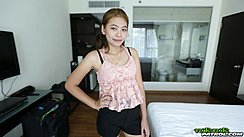 Mint Standing Beside Bed Hand On Hip